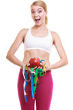 Happy woman holding apple and tape measures. Stock Image