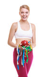 Happy woman holding apple and tape measures. Stock Photography