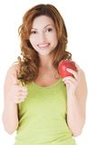Happy woman holding an apple with thumb up Royalty Free Stock Images