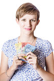 Happy woman holding Australian money Royalty Free Stock Image