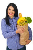 Happy woman holding bag with food Royalty Free Stock Photo