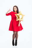Happy woman holding balloon and showing thumb up Stock Photography