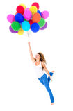 Happy woman holding balloons Stock Images
