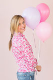 Happy Woman Holding Balloons Against Pink Background Stock Photography