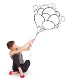 Happy woman holding balloons drawing Stock Photo