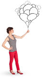 Happy woman holding balloons drawing Royalty Free Stock Photography