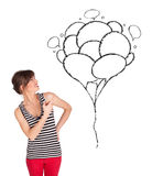 Happy woman holding balloons drawing Stock Images