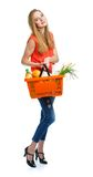 Happy woman holding a basket full of healthy food. Shopping Stock Image
