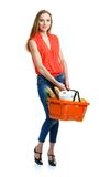 Happy woman holding a basket full of healthy food. Shopping Royalty Free Stock Photo