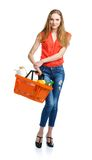 Happy woman holding a basket full of healthy food. Shopping Stock Photo