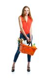 Happy woman holding a basket full of healthy food. Shopping Stock Images