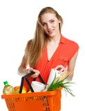Happy woman holding a basket full of healthy food. Shopping Stock Photography