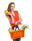 Happy woman holding a basket full of healthy food. Shopping Royalty Free Stock Images