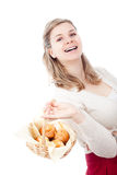 Happy woman holding basket with muffins Stock Photo
