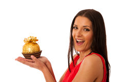 Happy woman holding big chocolate candy received as a gift. Stock Photos