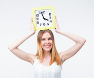 Happy woman holding big clock on head Royalty Free Stock Images