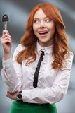 Happy woman holding big key Stock Images