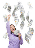 Happy Woman Holding the $100 Bills with Many Falling Around Royalty Free Stock Images