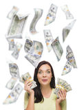Happy Woman Holding the $100 Bills with Many Falling Around Stock Images
