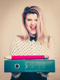 Happy woman holding binder with documents and pencil Royalty Free Stock Images