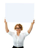 Happy woman holding blank billboard Stock Photo