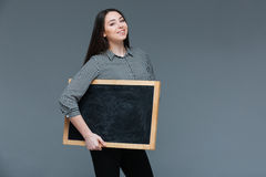 Happy woman holding blank black board Royalty Free Stock Photo