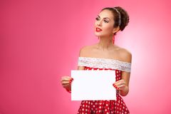 Happy Woman Holding Blank Card. Pin-Up Retro Royalty Free Stock Image