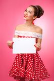Happy Woman Holding Blank Card. Pin-Up Retro Stock Photo