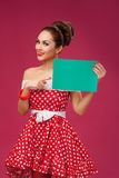 Happy Woman Holding Blank Card. Pin-Up Retro Stock Image