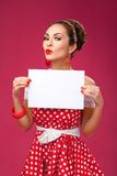 Happy Woman Holding Blank Card. Pin-Up Retro Stock Images
