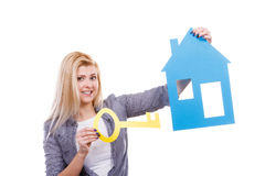 Happy woman holding blue paper house Stock Photography