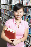 Happy Woman Holding Books Royalty Free Stock Photography