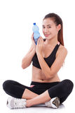 Happy woman holding bottle of water Stock Image