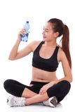 Happy woman holding bottle of water Stock Photos