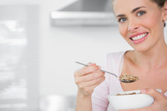 Happy woman holding bowl of cereal Stock Image