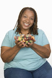Happy Woman Holding Bowl Of Fruit Salad Stock Image