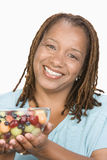 Happy Woman Holding Bowl Of Fruit Salad Stock Photos