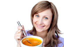 Happy woman holding a bowl with orange soup Royalty Free Stock Photo