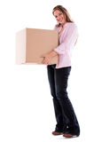 Happy woman holding a box Royalty Free Stock Photos