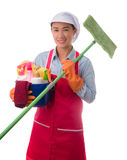 Happy woman holding a bucket full of cleaning supplies isolated Stock Photo