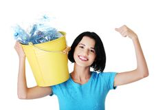 Happy woman holding bucket of plastic rubbish Royalty Free Stock Images