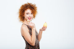 Happy woman holding cake Royalty Free Stock Images