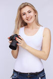 Happy woman holding camera Stock Image