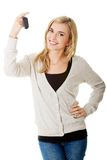 Happy woman holding a car key Royalty Free Stock Images