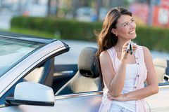 Happy woman holding car keys Stock Photo