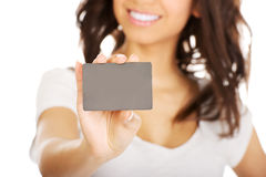 Happy woman holding a card. Stock Photos