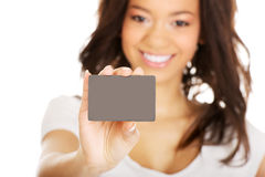 Happy woman holding a card. Stock Photo