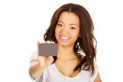 Happy woman holding a card. Royalty Free Stock Photos