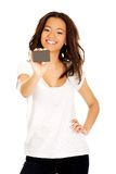 Happy woman holding a card. Stock Images