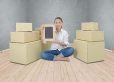 Happy woman holding chalkboard, business for delivery object int royalty free stock photo